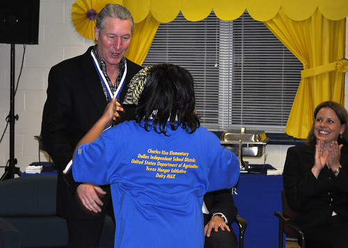 Southwest Regional Administrator Bill Ludwig receives a gold medal from Charles Rice Learning Center for being a breakfast champion.