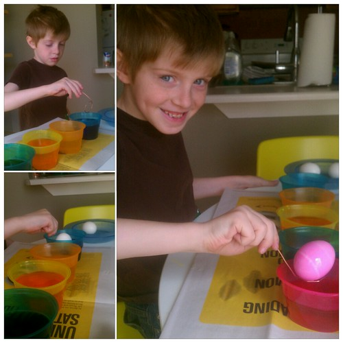 Holden dipping eggs