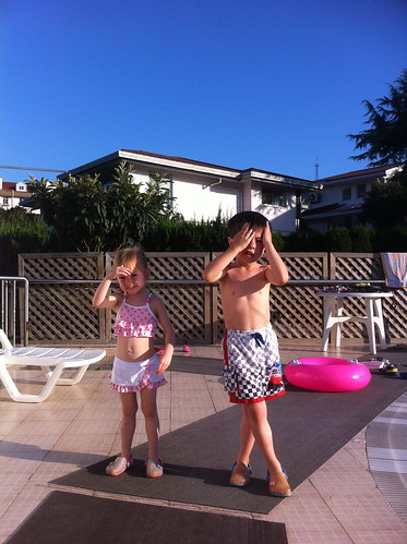 Scott and Elaine at the pool, the sun is too bright fro them