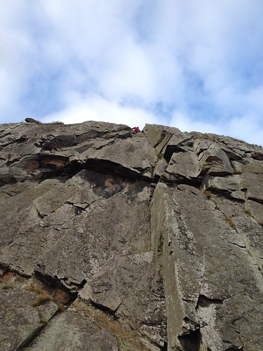 Euan Whittaker at the top of Overhang Wall, Traprain Law