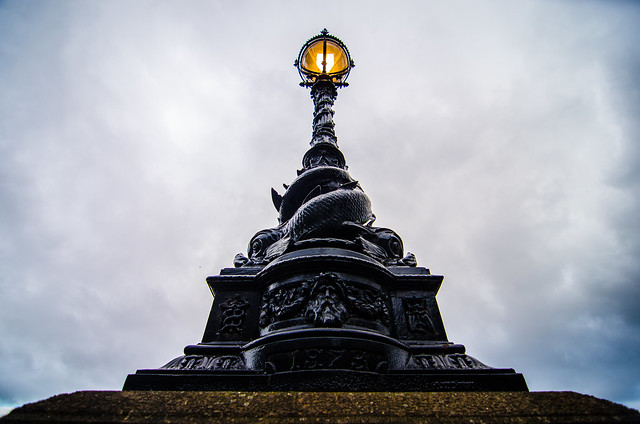 An ornate lamppost along the banks of London's River Thames.