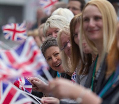 Well wishers wait outside Greater Manchester University Hospital to see The Queen arrive