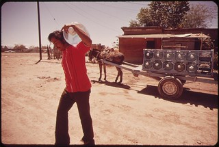 A vendor delivers bottled water from a nearby spring to a home in Mexicali, Mexico. Colorado River water is not drinkable here, April 1973