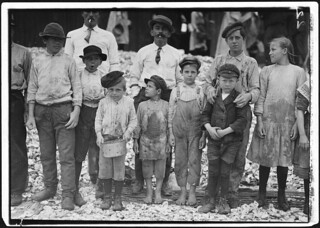 All these are shrimp pickers. Youngest in photo are 5 and 8 years old. Biloxi, Miss, February 1911