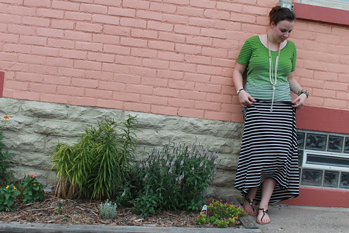 Black and white striped jersey maxi skirt, striped ombré t-shirt with crisscross back, coral and pearl sandals, knotted pearls, ribbon and bead necklace, pavé cable link bracelet from J.Crew, bangles, etc.