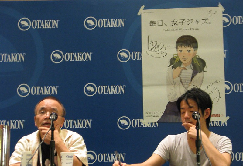 Masao Maruyama speaks about Kids on the Slope (pictured on the back wall) while his translator takes notes