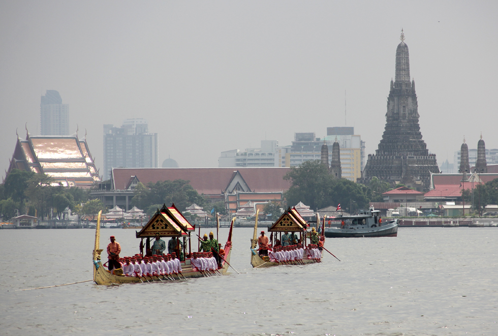 Thai Royal Barge Procession with Wat Arun is the Distance