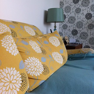 Duck egg blue lamp, throw and leaves on the sofa
