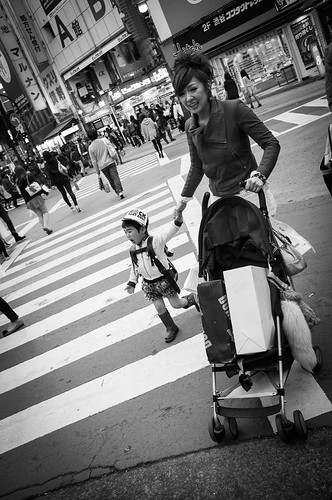 Mother with child crossing the road at Shibuya. Tokyo 2012