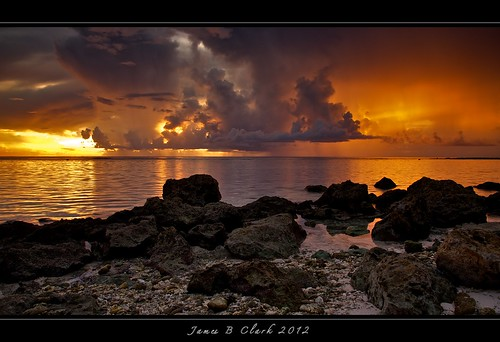 ocean longexposure sunset sea sky sun color reflection art beach nature clouds reflections outdoors island james islands coast sand nikon exposure raw seascapes dusk sunsets clark reef shores guam tumonbay jamesclark nikon24120 sunsetphotos tripodshots d700 nikond700 mygearandme