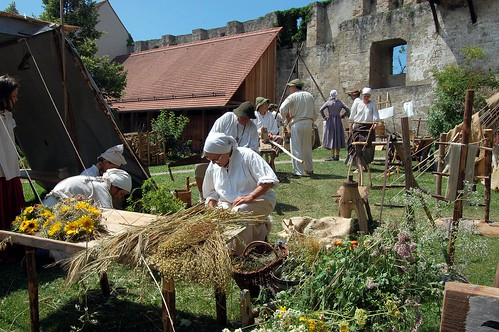 Peasants at Burgfest gathering flowers