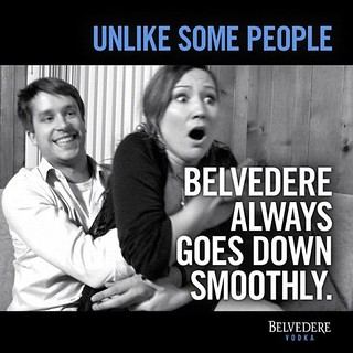 the Belvedere ad in question that pictures a young woman who looks horrified being pulled into the lap of a smiling young man. the text reads Unlike some people, Belvedere always goes down smooth