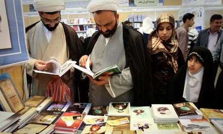 men and women browsing the selections at the book fair