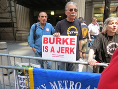 Chuck Zlatkin of the New York Metro Area Postal Union holds a sign denouncing Con Edison CEO Kevin Burke.
