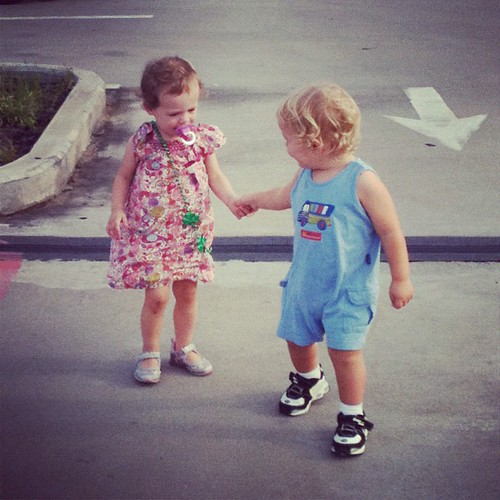 August. Nothing cuter than toddlers holding hands.