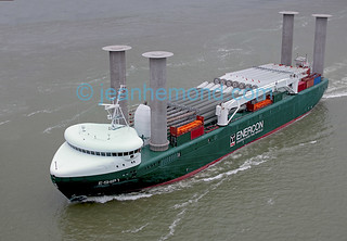 Aerial view of Enercon E-Ship 1.  All copyrights registered. A ship with Flettner rotors assisted propulsion  showing a deck load of wind generators. Thiiink  copyright infrigement