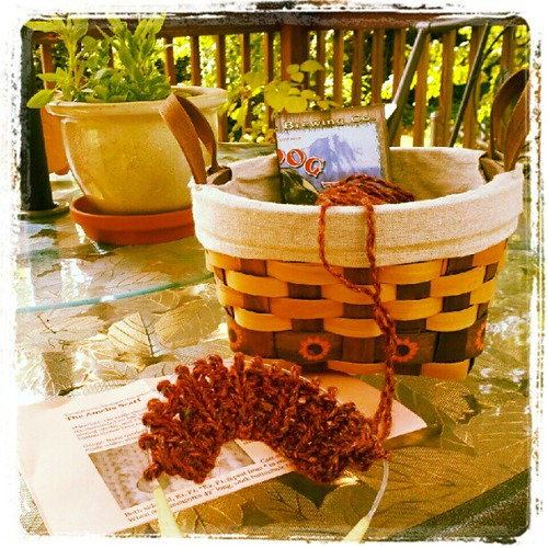 Sitting on the #deck with the #dogs #knitting while he works on the #racecar today. Happy #sunday ... #yarn #knit #debbiebliss #scarf #sunflower #summer #fall
