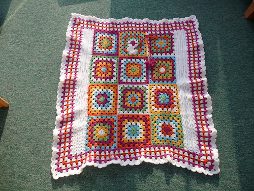 I think this blanket is so interesting with the centre square and border!