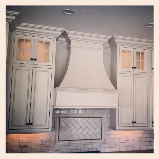 White kitchen with herringbone subway tile. #louisville #custom