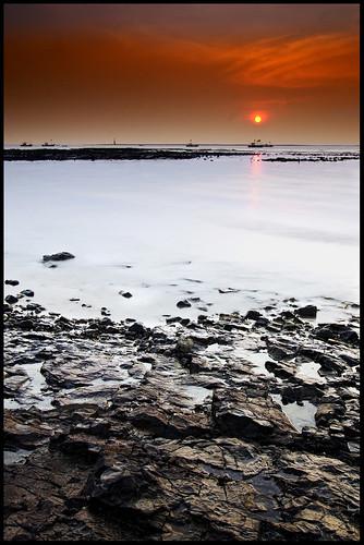 longexposure sunset orange india seascape reflection beach rock sunrise boat orangesky mumbai filters ndfilter ndgrad d7000 indiaseascape mumbaiseascape