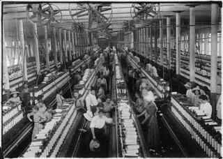 Interior of Magnolia Cotton Mills spinning room. See the little ones scattered through the mill. All work. Magnolia, Miss, May 1911