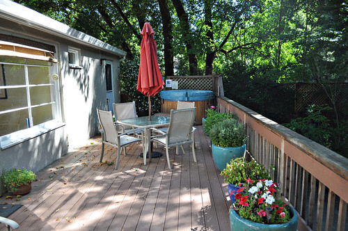 Deck with Hot Tub at Kenwood Cottage