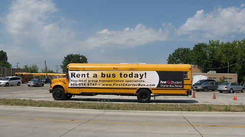 First Student school bus with advertising banner attatched.  Glenview Illinois. July 2012. by Eddie from Chicago