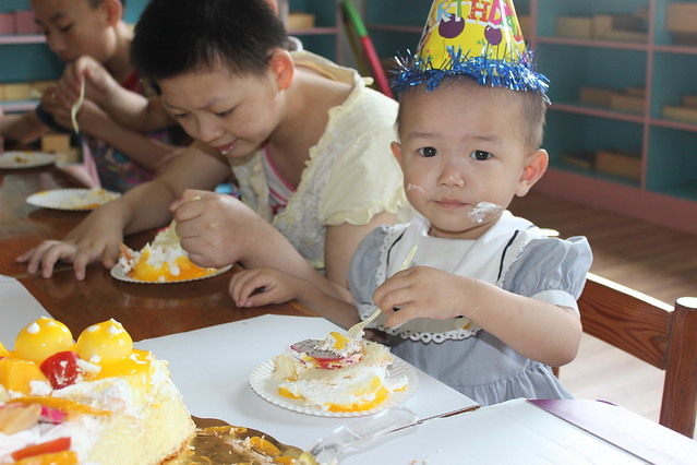 so beautiful... my littlest girl, in China, and the cake we had sent to her!