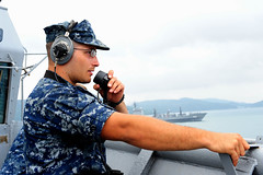 Seaman Bryant Fossier serves as starboard watch aboard USS Tortuga (LSD 46) as the ship departs Sasebo, Japan, Aug. 13 for a patrol in the U.S. 7th Fleet area of operations. (U.S. Navy Photo by Mass Communication Specialist 3rd Class Karen Blankenship)