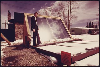 John Keyes, president of International Solarthermics Corporation, shown with the backyard solar heating system he developed…, 05/1975.