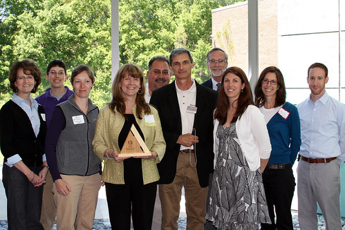 A segment of the Green Team from the NC Museum of Life & Science poses with their award.
