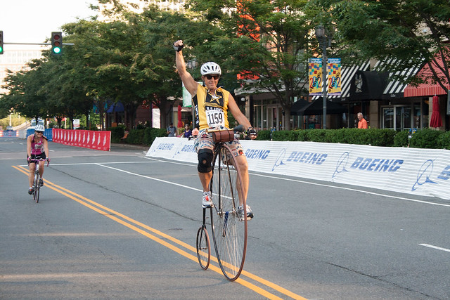 Army of One crosses the start on a penny farthing at the 2012 Crystal Ride.