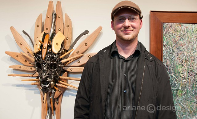 Artist Carl Sean McMahon with his piece