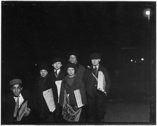 Group on Court St. selling around the Shea Theatre, 8 P.M. Boy in center, Vito Bucheto, 10 years old. Behind him to left, Tony Gregoria, 12 years old. Buffalo, N.Y, February 1910