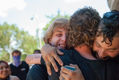 Arrested Occupier is greeted by his friends after release from mass arrest on Wildcat March during NATGAT July 1