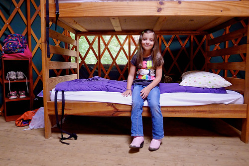 Claiming her bunk at camp.