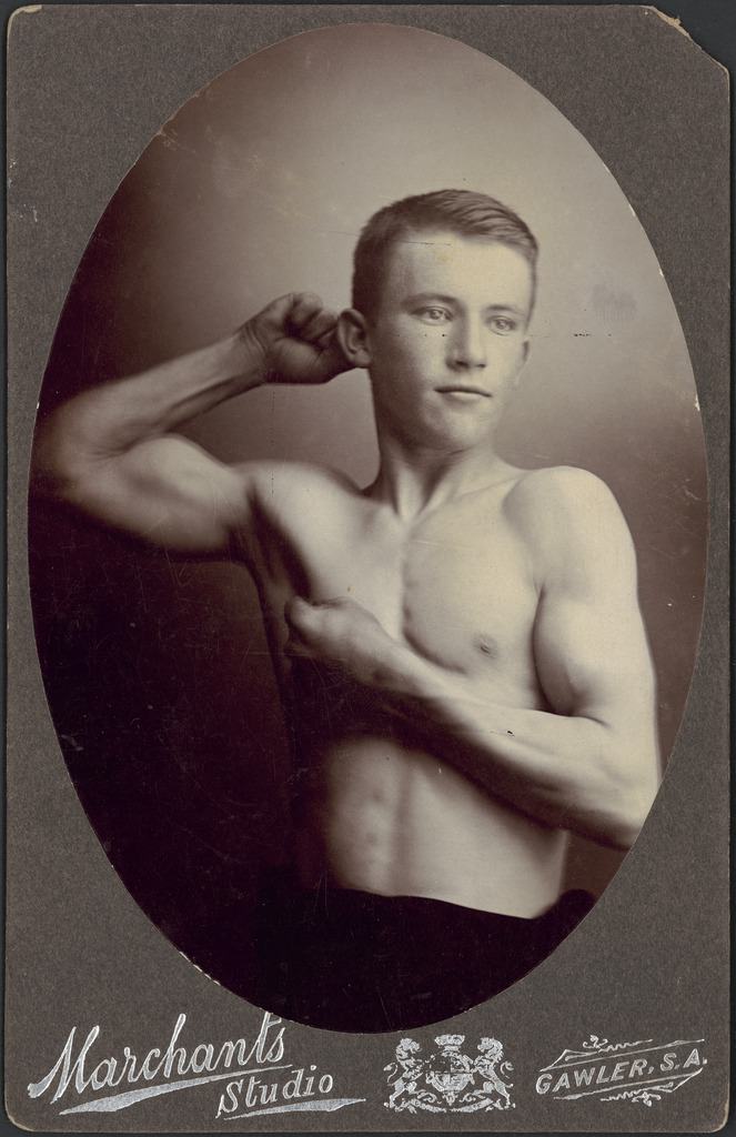 Young Australian male athlete flexing his muscles, ca. 1899