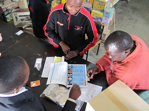 Going through the training materials at the Choma wholesaler