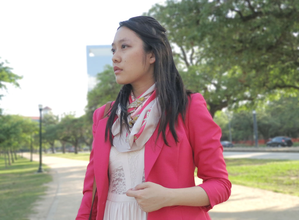 Coral and pink scarf with all-pink outfit and blazer