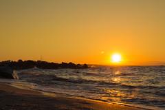 Big orange sun rising over horison on Azov sea