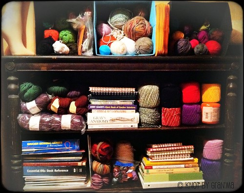 yarn storage on a bookshelf