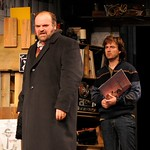 Marxist professor Max (Jack Willis) and his former pupil Jan (Manoel Felciano) debate political views in Jan's Prague apartment in the Huntington Theatre Company's production of Tom Stoppard's <i>Rock 'n' Roll</i> at the Avenue of the Arts/BU Theatre. Part of the 2008-2009 season.