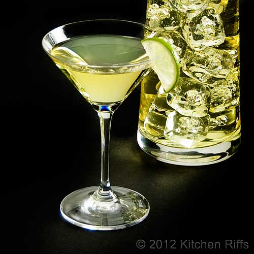 Gimlet Cocktail in Cocktail Glass with Lime Garnish, and Mixing Beaker, Black Background