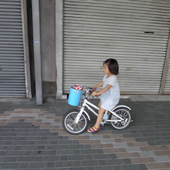 Young girl cycling Kyoto