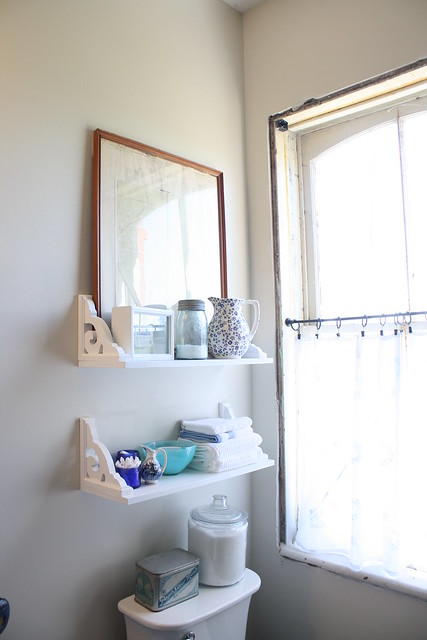 vintage inspired bathroom shelves with cobalt jars