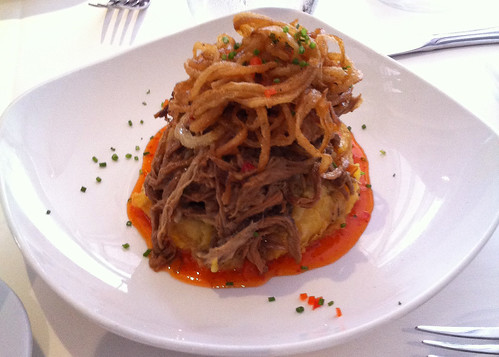 Ropa vieja with plantain fufu and fried onions