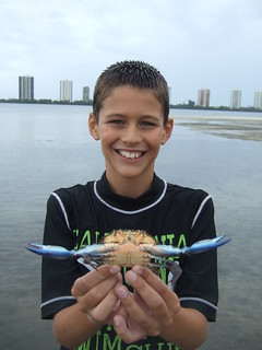 Michael catches another blue crab. | by AdventureMIke.com