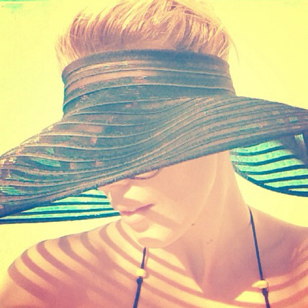 Topless hat... allows my roots to lighten naturally in the sun.