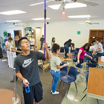 12-005 -- MALANA students got the chance to serve the community by helping set up and clean for the coming school year at the Unity Community Center.  Joshua Yoo '16 dusted ceiling fans.