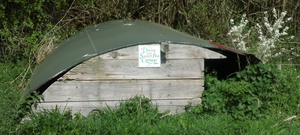 'Daisy and Sweet Pea Cottage' Could that be a line from 'Under Milk Wood' by Dylan Thomas? If not, it should be?